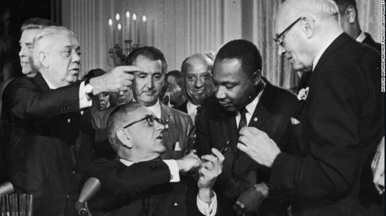http://uploads.bmxmuseum.com/user-images/156598/181008174452-lyndon-johnson-mlk-signing-of-civil-rights-act-exlarge-1695d659f93bb.jpg