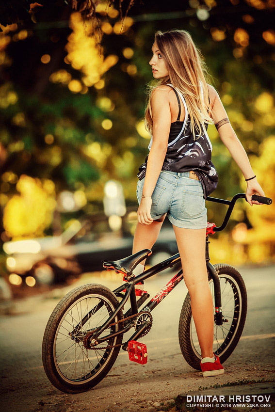 http://uploads.bmxmuseum.com/user-images/74614/lovely-young-woman-riding-a-bmx-bicycle_by_54ka5cff77f112.jpg